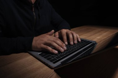 cropped shot of hacker using laptop, cuber security concept