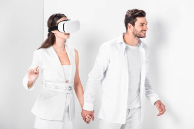 Adult man walking with woman in virtual reality headset stock vector