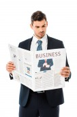 handsome businessman in suit reading business newspaper isolated on white
