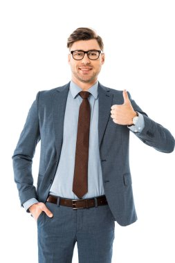 smiling businessman in glasses and suit showing thumbs up isolated on white