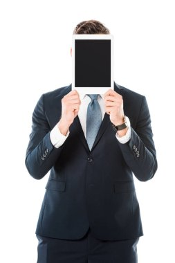 Businessman with obscure face holding digital tablet with blank screen isolated on white stock vector
