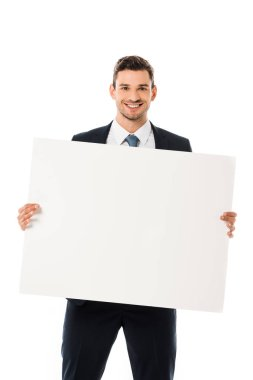 Smiling businessman in suit showing blank poster with copy space isolated on white stock vector