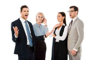 excited businessman standing with shocked coworkers isolated on white