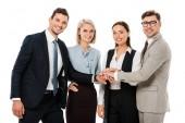 usmívající se úspěšný obchodní tým ruce společně izolované na bílém