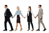 Fotografie confident businesspeople holding hands and walking ahead isolated on white