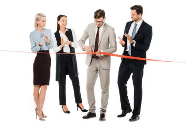 businessman cutting red ribbon on opening ceremony while colleagues applauding, isolated on white