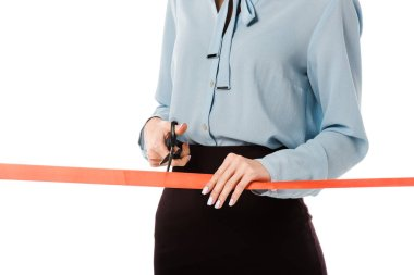 cropped view of businesswoman cutting red ribbon with scissors for grand opening, isolated on white