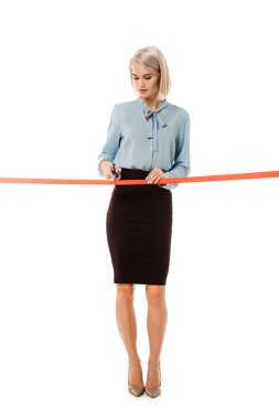beautiful businesswoman cutting red ribbon with scissors for grand opening, isolated on white