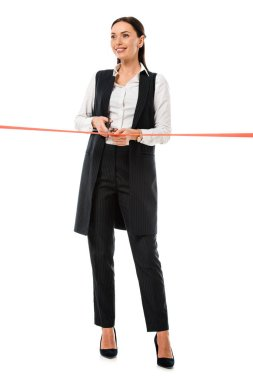 attractive businesswoman cutting red ribbon with scissors for grand opening, isolated on white