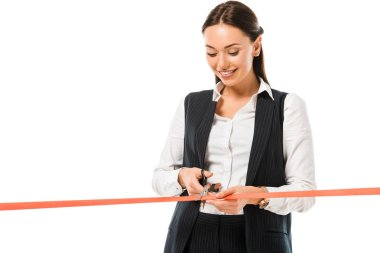 beautiful happy businesswoman cutting red ribbon with scissors on opening ceremony, isolated on white