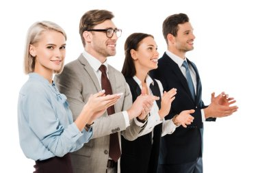 smiling successful business team applauding isolated on white