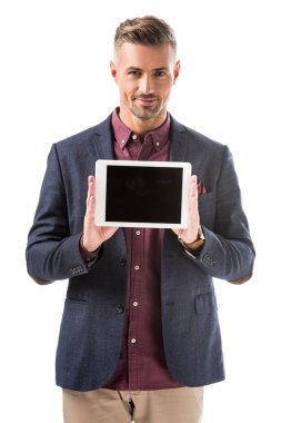 Smiling stylish man in jacket showing digital tablet with blank screen isolated on white stock vector