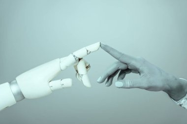 cropped shot of cyborg touching robotic arm isolated on grey, future technology concept