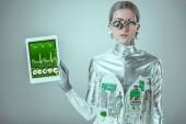 Fényképek ezüst robot gazdaságba tabletta orvosi készülék elszigetelt szürke, jövőbeni technológia koncepció