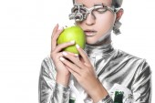 Fotografie silver robot holding apple with closed eyes isolated on white, future technology concept