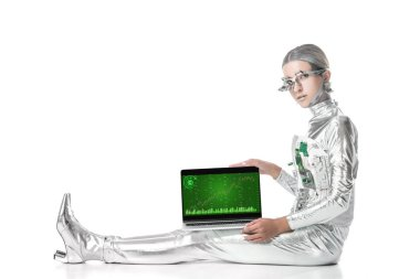 silver robot sitting and showing laptop with chart appliance isolated on white, future technology concept