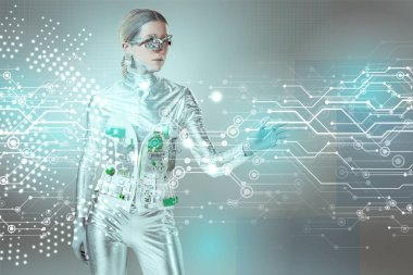silver robotic woman touching digital data with hand on grey, future technology concept