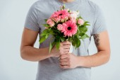 Fotografie cropped view of man holding pink flower bouquet isolated on grey