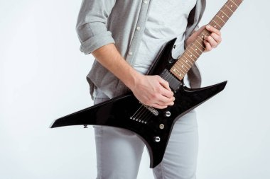 cropped view of man in grey clothing playing electric guitar isolated on white