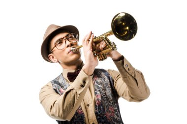 young mixed race man in stylish hat and eyeglasses playing on trumpet isolated on white