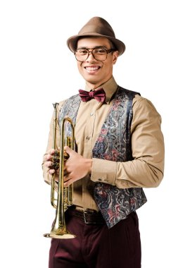 laughing young mixed race male jazzman posing with trumpet and looking at camera isolated on white