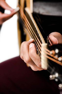 cropped image of male musician playing on acoustic guitar isolated on white