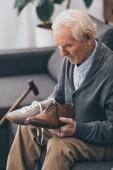 Fotografie senior man choosing between classic and modern shoes