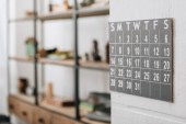 selective focus of wall calendar showing dates at living room