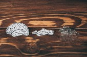 top view papers with brain disease as dementia symbol on wooden table