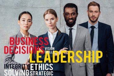 focused multiethnic group of businesspeople in formal wear posing and looking at camera with leadership illustration in front