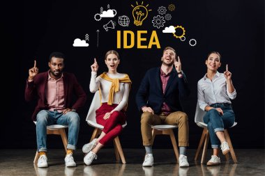multiethnic group of people sitting on chairs and showing idea gestures with idea illustration above heads isolated on black