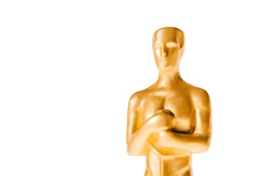 Close up of shiny golden oscar award isolated on white with copy space stock vector