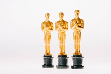 Row of golden oscar awards isolated on white stock vector