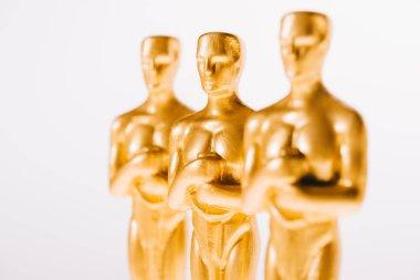 Selective focus of golden oscar awards isolated on white stock vector