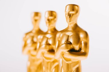 Close up of golden oscar statues isolated on white stock vector