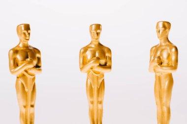 Golden oscar award figurines isolated on white stock vector