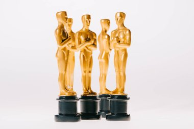 Shiny golden oscar trophies isolated on white stock vector