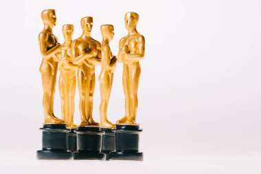 Golden oscar awards isolated on white with copy space stock vector