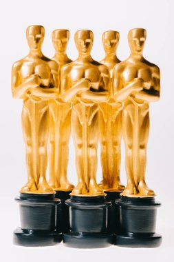Golden oscar award statuettes isolated on white stock vector