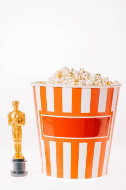 Shiny oscar award with popcorn cup isolated on white stock vector
