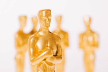 Close up of hollywood oscar award statuettes isolated on white stock vector