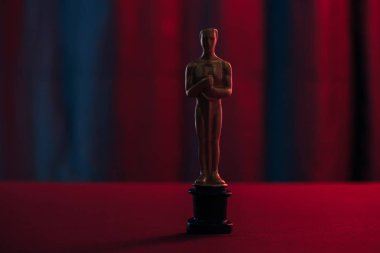 Golden oscar award on dark background with copy space stock vector