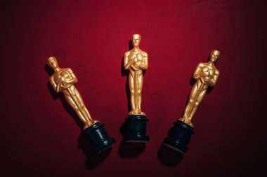 Top view of golden oscar award statuettes on red background stock vector