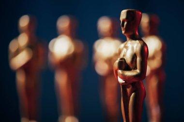 Selective focus of hollywood oscar award on dark background with copy space stock vector