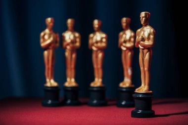 Row of hollywood golden oscar awards on dark background stock vector