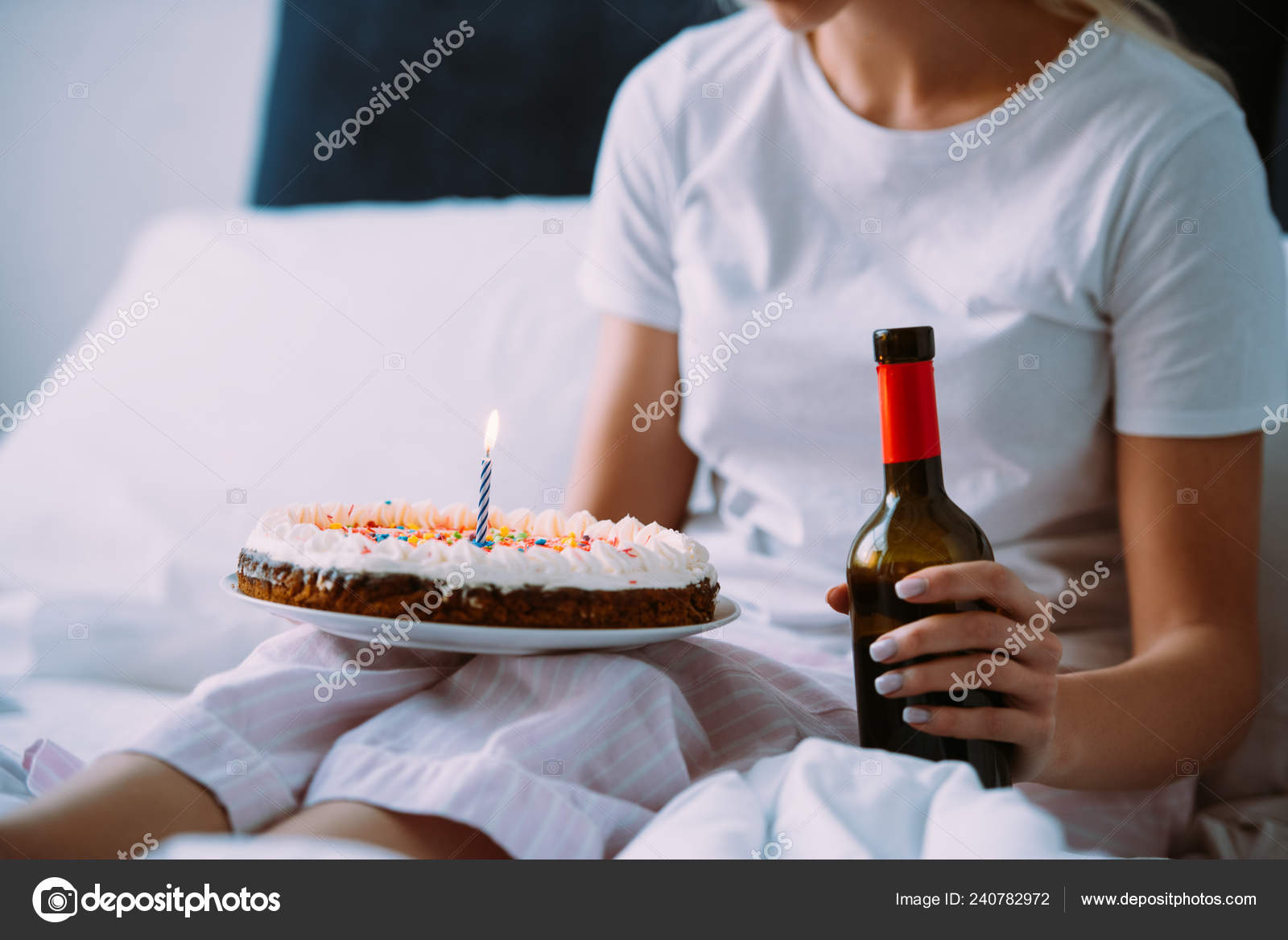 Cropped View Of Woman With Bottle Wine And Cake Celebrating Birthday In Bed Alone Stock Image