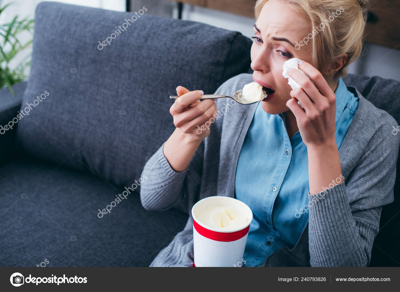 Woman Eating Ice Cream Crying While Siitng Couch Home Alone Stock