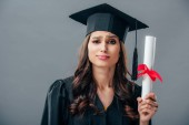 Photo female indian student in graduation hat holding diploma, isolated on grey