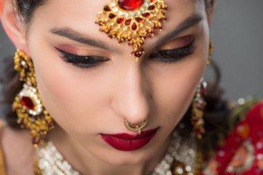 Indian girl posing in traditional bindi, isolated on grey stock vector