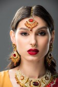 attractive indian woman in traditional bindi, isolated on grey